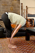 Stock Photo of a Woman Doing Yoga Women in Home Doing Yoga