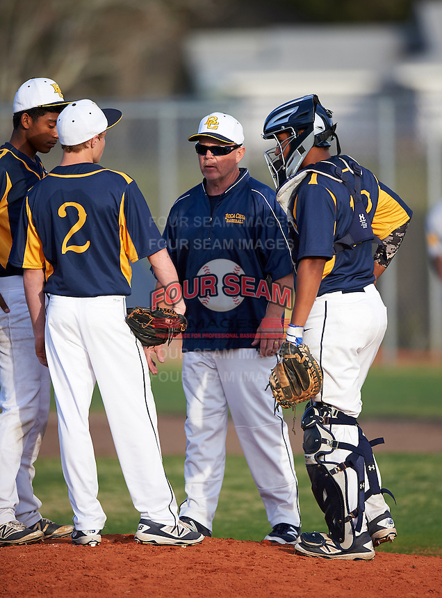 Boca Ciega Pirates assistant coach Richie Watkins talks with pitcher Andrew Pedroff (2) as Lazero Rodriguez (left) and catcher Ivan Rodriguez (12) listen in during a game against the Lakeland Spartans at Boca Ciega High School on March 2, 2016 in St. Petersburg, Florida.  Boca Ciega defeated Lakewood 2-1.  (Mike Janes/Four Seam Images)