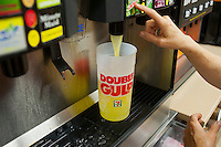 "A 64 ounce ""Double Gulp"" is seen being filled at a 7-Eleven store in New York on Thursday, May 31, 2012. New York Mayor Mike Bloomberg has proposed banning huge sized sugary drinks in an effort to combat the epidemic of obesity.  Bloomberg wants to impose a 16 ounce limit on sweetened beverages sold in graded food establishments and mobile food carts (businesses that the city has control over) with no restrictions on beverages with less than 25 calories per 8 ounces. (© Richard B. Levine)"
