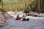 Gordon Congdon (stern) and Robert Scott bow launch below Log Jam Rapids No. 1 on the Gataga River in northeastern British Columbia.  Gataga-Kechika Management Area.