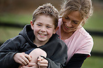 Jacob Kerr, 9, and his mother Susan hang out on their rural property in Central Saanich near Victoria, British Columbia. Jacob, who was diagnosed with cancer at age five, has lost his high frequency hearing after taking cisplatin for his neuroblastoma, a type of cancer that begins with emryonic cells which normally develop into parts of our nervous system. Photo assignment for the Globe and Mail national newspaper in Canada.