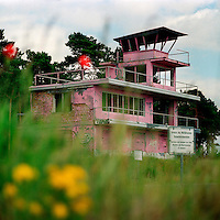 Deserted observation tower in a former shooting range of the Soviet army. The terrain is now used by the German army. Protesters painted the tower pink in protest to the area being re-used by Germany for military manoeuvres. The Cold War, which formed part of the collective consciousness of post war Europe from 1945 until 1989, dominated the military and political landscape. These sparse and ageing relics of the covert war in Europe remain as testaments to the existence of this significant period in the shared history of the East and West. CHECK with MRM/FNA