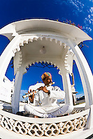 Like something out of Arabian Nights, this amazing flute player played in the morning under a bright blue Indian sky.<br /> (Photo by Matt Considine - Images of Asia Collection)
