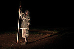 GULU, UGANDA MAY 26: A boy arrives at a shelter from his village as the sun sets on May 26, 2005 in Gulu, Uganda. He is one of about 20,000 night commuters that sleep in Gulu town every night, as they are afraid of being abducted by the Lord's Resistance Army (LRA). The rebel group has brought terror to Northern Uganda for almost twenty years, fighting the Ugandan government. The victims are usually children, which are abducted and used as child soldiers and sex slaves. Some children walk for hours from their home every day to sleep at Noah's Arch, an NGO housing children in Gulu. They are too afraid of sleeping in the villages. (Photo: Per-Anders Pettersson)..