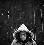 Victor Spinski, my father, stands for a portrait next to his barn during a snow storm in the winter of 2009.