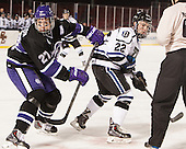 Shayne Stockton (HC - 27), Derek Bacon (Bentley - 22) - The Bentley University Falcons defeated the College of the Holy Cross Crusaders 3-2 on Saturday, December 28, 2013, at Fenway Park in Boston, Massachusetts.