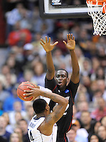 Alex Oriakhi of the Huskies shoots over Bearcats' Ibrahima Thomas. UConn defeats Cincinnati 69-58 during the 3rd round of the NCAA Tournament at the Verizon Center in Washington, D.C on Saturday, March 19, 2011. Alan P. Santos/DC Sports Box