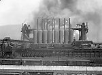 Pittsburgh PA:  View of the J&L Steel Mill on the Monongahela River. Billowing smoke coming from the blast furnaces - 1960