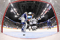 Toronto Marlies goaltender Christopher Gibson, left, stands in his crease as San Antonio Rampage players celebrate a second-period goal by Rampage captain Greg Rallo during an AHL hockey game, Sunday, Nov. 24, 2013, in San Antonio. (Darren Abate/AHL)