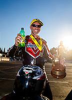 Nov 13, 2016; Pomona, CA, USA; NHRA pro stock motorcycle rider Matt Smith celebrates after winning the Auto Club Finals at Auto Club Raceway at Pomona. Mandatory Credit: Mark J. Rebilas-USA TODAY Sports