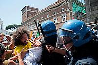 Roma 27 Giugno 2012.Manifestazione  dei sindacati di base  contro la riforma del lavoro e il ministro Fornero.La polizia carica i manifestanti in piazza Venezia mentre tentano di raggiungere Montecitorio