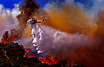 A helicopter drops water on a brushfire near Vista Del Valle in Griffith Park in Los Angeles Tuesday May 08, 2007.