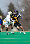 10 April 2011: University at Albany Great Dane attacker Ty Thompson, a Freshman from Hogansburg, NY, in action against the University of Vermont Catamounts on Moulton Winder Field in Burlington, Vermont. The Catamounts defeated the visiting Danes 11-6 in America East play. Mandatory Credit: Ed Wolfstein Photo