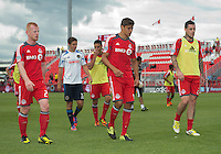 15 September 2012: Toronto FC defender Richard Eckersley #27, Toronto FC defender Adrian Cann #12 and Toronto FC forward Eric Hassli #29 walk off the pitch after the warm-up in an MLS game between the Philadelphia Union and Toronto FC at BMO Field in Toronto, Ontario..The game ended in a 1-1 draw..