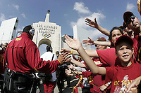 7 October 2006: Fans celebrate and welcome players into the stadium two hours before the game.  NCAA College Football Pac-10 USC Trojans 26-6 win over the Washington Huskies at the LA Coliseum during a sunny saturday game in Los Angeles, CA.<br />