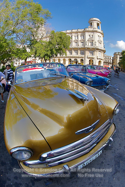 TH0177-Dm. Vintage American cars lined up in Parque Central in Old Havana (Habana Vieja in Spanish). Havana, Cuba.<br /> Photo Copyright &copy; Brandon Cole. All rights reserved worldwide.  www.brandoncole.com