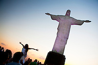 International tourists posing and taking pictures at Brazil most known landmark, Christ the Redeemer statue, Corcovado, Rio de Janeiro.