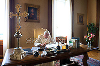 Pope Benedict XVI reads a document in his office in the papal summer retreat of Castel Gandolfo, on July 23, 2010 on the hills in the outskirts of Rome. SPAZIANI/ POOL/ OSSERVATORE ROMANO
