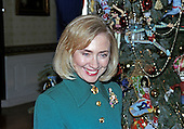 First lady Hillary Rodham Clinton guides members of the press through the White House Christmas decorations in Washington, DC on December 2, 1996.  Here the first lady is photographed with the White House Christmas Tree in the Blue Room.<br /> Credit: Ron Sachs / CNP