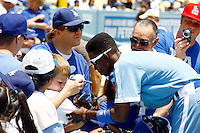 15 June 2011: Dodgers Shortstop #9 Dee Gordon signs autographs before a Major League Baseball game where the LA Dodgers were defeated 7-2 by the Cincinnati Reds at Dodger Stadium during a day game. Players are wearing throwback uniforms from the 1940's. **Editorial Use Only**