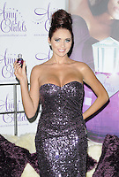 Amy Childs.The photocall to launch her debut fragrance in collaboration with Jigsaw, Aura bar & nightclub, London, England..August 15th, 2012.half length purple strapless dress  sequins sequined hair up bun hand on hip .CAP/CAN.©Can Nguyen/Capital Pictures.