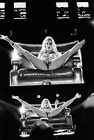 Switzerland. Canton Ticino. Lugano. Biggi Bardot is a german porno actress. She is stripping naked on stage with both legs open and masturbating. Extasia 2014 is the first erotic and sex fair in southern Switzerland. 1.02.14 © 2014 Didier Ruef