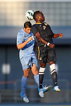 31 August 2012: West Virginia's Peabo Doue (11) and UNC's Jordan Gafa (14) challenge for a header. The University of North Carolina Tar Heels defeated the West Virginia University Mountaineers 1-0 at Fetzer Field in Chapel Hill, North Carolina in a 2012 NCAA Division I Men's Soccer game.