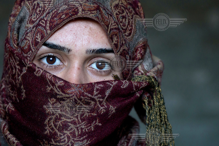 A portrait of a 20 year old Yazidi woman who was captured by Islamic State (IS) on 3 August 2014 in Sinjar when IS fighters attached the city. She was beaten with sticks every day because she refused to convert to Islam. She was held captive for 4 months in various locations. One night she escaped with seven other women of whom two were captured again. She now lives in a small house with her family. Her 12 year old brother is still in IS captivity.