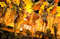 Dancers of Imperatriz samba school perform on a float during the Carnival parade at the Sambadrome in Rio de Janeiro, Brazil, 20 February 2012. The Carnival in Rio de Janeiro, considered the biggest carnival in the world, is a colorful, four day celebration, taking place every year forty days before Easter. The Samba school parades, featuring thousands of dancers, imaginative costumes and elaborate floats, are held on the Sambadrome, a purpose-built stadium in downtown Rio. According to costumes, flow, theme, band music quality and performance, a single school is declared the winner of the competition.
