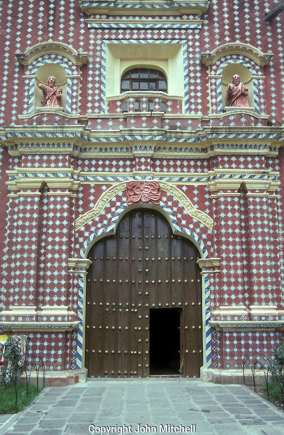 The Talavera tiled facade of the Templo de Santa Maria in the village of Tonantzintla, Pueble state, Mexico