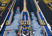 Jun 17, 2016; Bristol, TN, USA; NHRA pro stock driver V Gaines (left) does a burnout alongside Shane Gray during qualifying for the Thunder Valley Nationals at Bristol Dragway. Mandatory Credit: Mark J. Rebilas-USA TODAY Sports