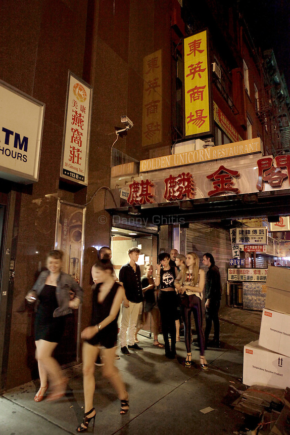 Club-goers step outside for a smoke during a night of partying at Madam Wong night club. By day Golden Unicorn is a traditional Chinese restaurant, but it is transformed into Madam Wong, a trendy Manhattan club at night. ..Danny Ghitis for The New York Times