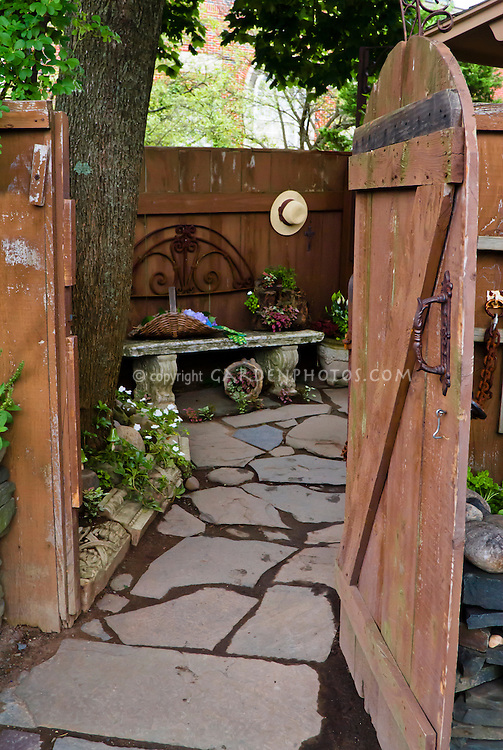 Rustic wooden fence and gate plant flower stock