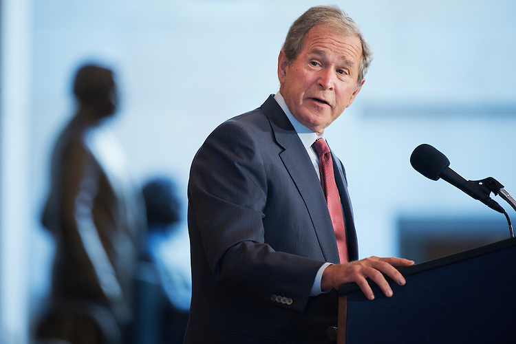 UNITED STATES - DECEMBER 03: Former President George W. Bush makes remarks during a bust unveiling ceremony for former Vice President Dick Cheney in the Capitol Visitor Center's Emancipation Hall, December 3, 2015. (Photo By Tom Williams/CQ Roll Call)