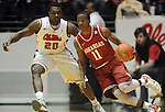 "Arkansas' B.J. Young (11) dribbles againt Mississippi's Nick Williams (20) at the C.M. ""Tad"" Smith Coliseum in Oxford, Miss. on Saturday, January 19, 2013. (AP Photo/Oxford Eagle, Bruce Newman)"