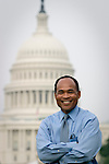 Tony Dorsey, general assignment reporter for WRC television news in Washington, poses on the National Mall in front of the U.S. Capitol.