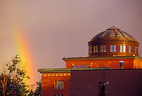 A rainbow is seen with the Marquette County Courthouse in Marquette, Mich.