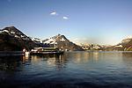 Ferry cruising  on the lake Stätten See at dusk. Beckonried, Switzerland.