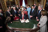 United States President Donald Trump is joined by the Congressional leadership and his family as he formally signs his cabinet nominations into law, in the President's Room of the Senate, at the Capitol in Washington, Friday, Jan. 20, 2017. From left are US Senate Minority Leader Chuck Schumer (Democrat of New York), US Senator Roy Blunt (Republican of Missouri), Donald Trump Jr., US Vice President Mike Pence, Jared Kushner, Karen Pence, Ivanka Trump, Barron Trump, Melania Trump, Speaker of the US House Paul Ryan (Republican of Wisconsin), US House Majority Leader Kevin McCarthy (Republican of California), and US House Minority Leader Nancy Pelosi (Democrat of California)<br /> Credit: J. Scott Applewhite / Pool via CNP