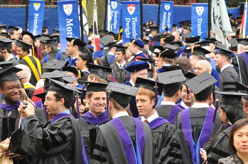 Yale University Commencement 2009   Students Congregating on Cross Campus before the Ceremony. Caps, Gowns & Residential banners in background.