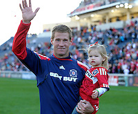 Chicago Fire forward Brian McBride (20) thanks the fans while circling the field with his daughter. This game was McBride's last home game for the Fire.  The Chicago Fire tied DC United 0-0 at Toyota Park in Bridgeview, IL on Oct. 16, 2010.