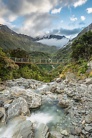 Wild Tekano Creek with swingbridge near Douglas Rock Hut in Copland Valley at sunrise, Westland National Park, West Coast, South Westland, World Heritage Area, New Zealand