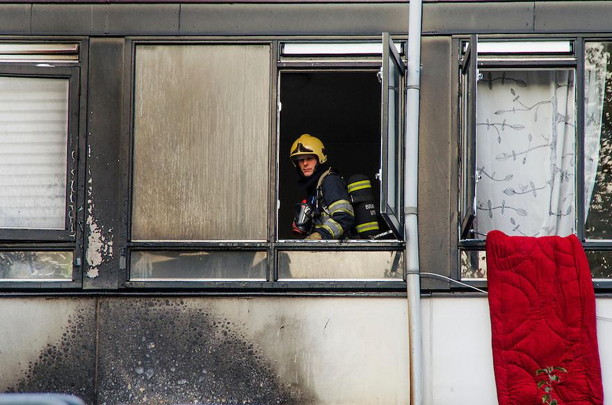 Nederland, Utrecht, 3 okt 2014<br /> Brandweer controleert een huis wat zojuist in brand heeft gestaatn <br /> Foto: (c) Michiel Wijnbergh