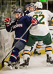 20 January 2017: University of Connecticut Husky Forward Evan Richardson, a Senior from Nanaimo, British Columbia, is checked by University of Vermont Catamount Forward Brady Shaw, a Senior from Ottawa, Ontario, during first period action at Gutterson Fieldhouse in Burlington, Vermont. The Huskies fell to the Catamounts 5-4 in the first game of their Home-and-Home Hockey East Series. Mandatory Credit: Ed Wolfstein Photo *** RAW (NEF) Image File Available ***