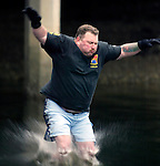Mark Taylor, of Port Orchard, Washington, hits the water during the 23rd annual Olallar polar bear jump into the Burley lagoon in Olalla, Washington on January 1, 2007. Jim Bryant Photo. ©2010. ALL RIGHTS RESERVED.