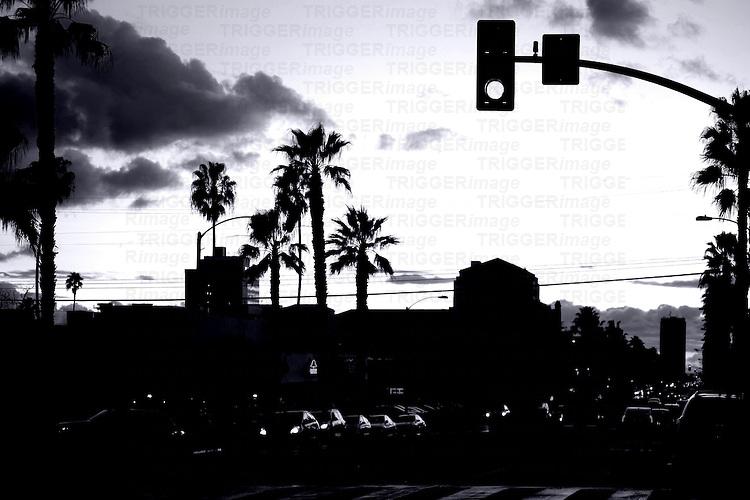 Road traffic on Santa Monica Boulevard during the sunset.