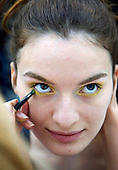 Top Russian model Katerina Smutok, 18, receives make-up during the Fashion Week in Moscow. She is modelling for Moscow-based Teplitskaya Design...Photograph by Justin Jin