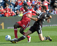 DC United defender Dejan Jakovic (5) slide tackles the ball away from Chicago Fire forward Patrick Nyarko (14).  The Chicago Fire tied DC United 0-0 at Toyota Park in Bridgeview, IL on Oct. 16, 2010.