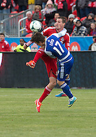 06 April 2013: Toronto FC forward Justin Braun #17 and FC Dallas defender Zach Loyd #17 in action during an MLS game between FC Dallas and Toronto FC at BMO Field in Toronto, Ontario Canada..The game ended in a 2-2 draw..