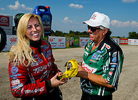 Sep 21, 2014; Ennis, TX, USA; NHRA funny car driver Courtney Force (left) celebrates with father John Force after winning the Fall Nationals at the Texas Motorplex. Mandatory Credit: Mark J. Rebilas-USA TODAY Sports
